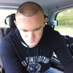 Wayne Rooney showing his hair transplant in 2011