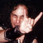 Long curly hair hairstyle for men with devil sign