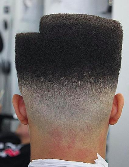 A great illustration of a guy with the perfect high top fade haircut shaped with a step on the hair
