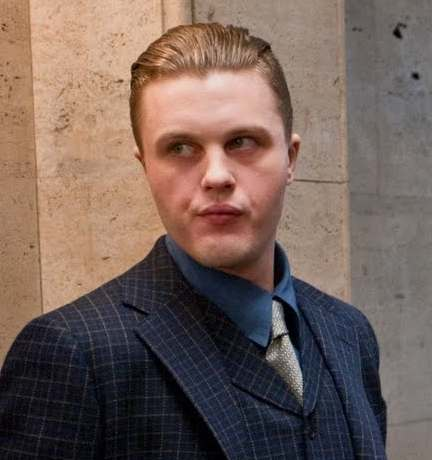 A picture of Jimmy Darmody with a slicked back undercut hairstyle for his straight hair