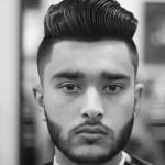 A picture of an Asian male with a cool short taper haircut blended with a quiff hairstyle