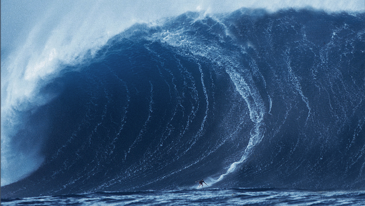A huge wave surfed by Garrett McNamara in Portugal