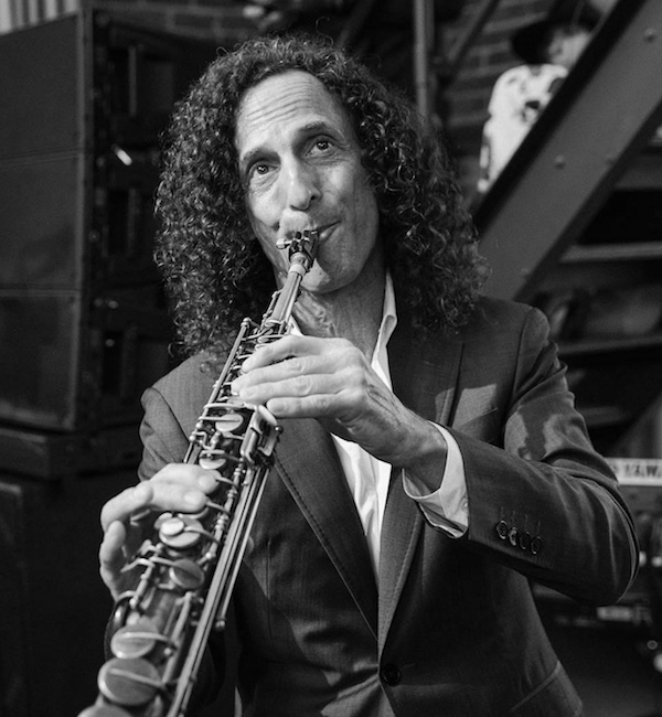 Kenny G with long curly hair to shoulder length
