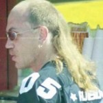 A balding man with a short haircut and a Mullet hair style