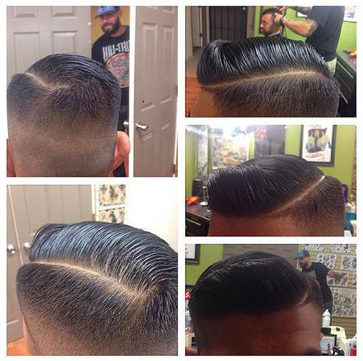 A hair salon photograph of a male with a cool executive contour haircut and a side part hairstyle